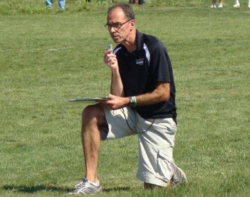 Coach Mike Kline taking notes during a meet.