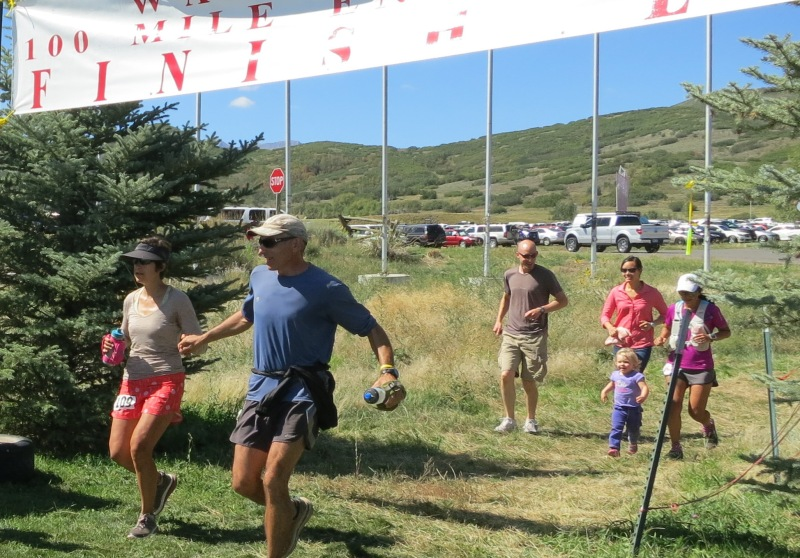 Andrea and Howie finishing Wasatch Front 100 2014, family and pacer in tow.